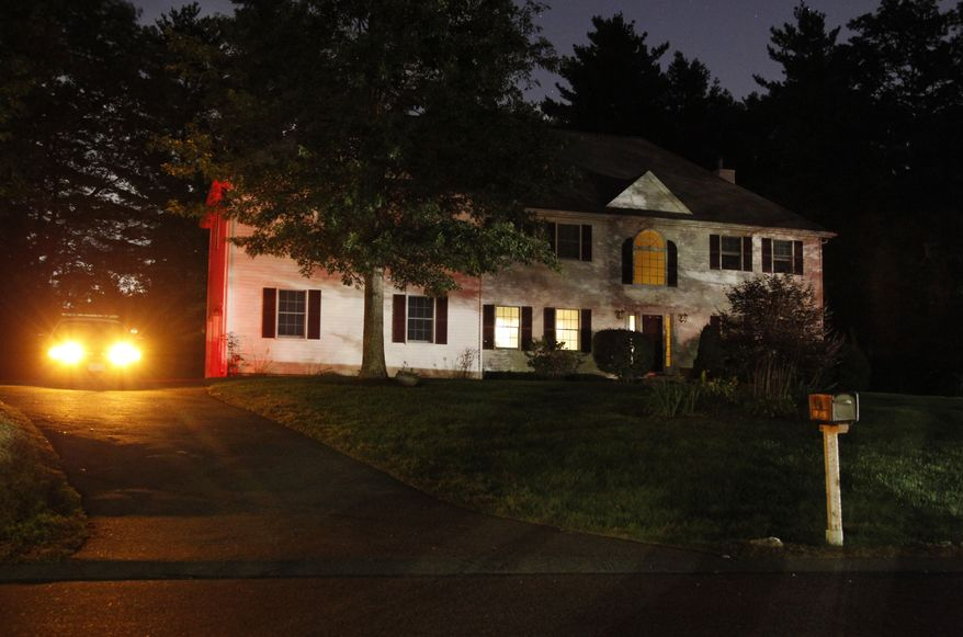 A police car sits in the driveway of the home of 26-year-old Rezwan Ferdaus in Ashland, Mass., on Wednesday, Sept. 28, 2011. Mr. Ferdaus is accused of plotting to destroy the Pentagon and the U.S. Capitol with large, remote-controlled aircraft filled with explosives. (AP Photo/Steven Senne)