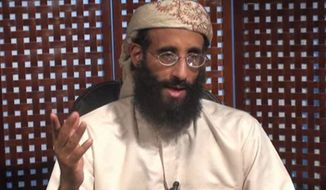 **FILE** In this image taken from video on Nov. 8, 2010, and released by SITE Intelligence Group, Anwar al-Awlaki speaks in a video message posted on radical websites. (Associated Press/SITE Intelligence Group)