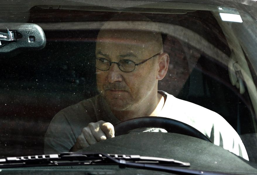 Boston Red Sox manager Terry Francona departs Fenway Park in Boston on Sept. 30, 2011, after meeting with Red Sox management to discuss his future with the baseball club. (Associated Press)