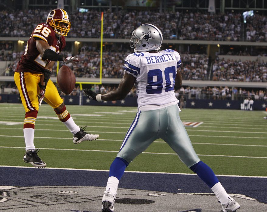 Washington Redskins cornerback Josh Wilson (26) breaks up a pass in the end zone intended for Dallas Cowboys tight end Martellus Bennett (80) on Monday, Sept. 26, 2011, in Arlington, Texas. The Cowboys won 18-16. (AP Photo/LM Otero)
