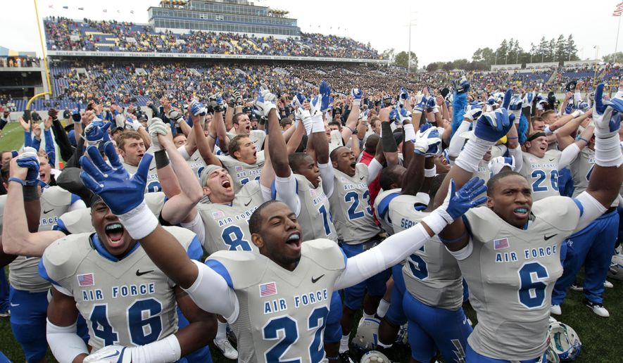 Air Force players celebrate with the crowd after defeating Navy 35-34 in overtime in an NCAA college football game, Saturday, Oct 1, 2011, in Annapolis, Md. (AP Photo/Luis M. Alvarez)