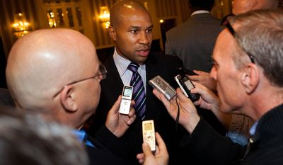 Derek Fisher, center, Los Angeles Lakers point guard and president of the NBA Players Association, speaks to reporters after a five-hour meeting with owners to discuss a new labor deal and possibly avert a lockout on Friday, Sept. 30, 2011, in New York. (AP Photo/John Minchillo)