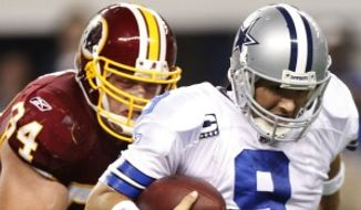 Washington Redskins defensive end Adam Carriker tackles Dallas Cowboys quarterback Tony Romo during the second half Monday, Sept. 26, 2011, in Arlington, Texas. Carriker has four tackles and 1.5 sacks on the season. (AP Photo/LM Otero)