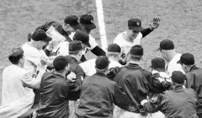"Bobby Thomson (center, hand raised) won the 1951 NL pennant for New York with a three-run homer off Brooklyn's Ralph Branca. Thomson's ""Shot Heard 'Round the World,"" which gave the Giants a 5-4 victory, is considered one of the most dramatic moments in sports history. (Associated Press)"