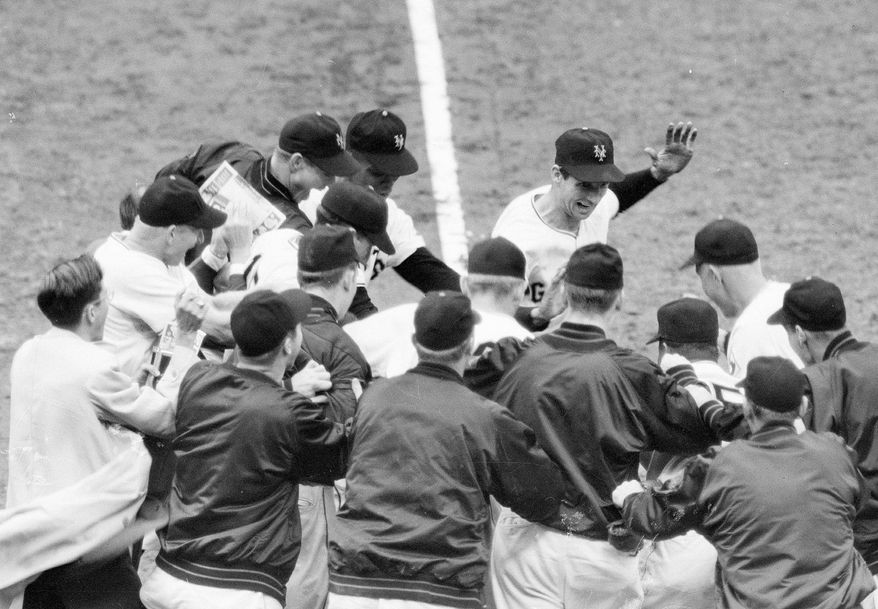 """Bobby Thomson (center, hand raised) won the 1951 NL pennant for New York with a three-run homer off Brooklyn's Ralph Branca. Thomson's """"Shot Heard 'Round the World,"""" which gave the Giants a 5-4 victory, is considered one of the most dramatic moments in sports history. (Associated Press)"""