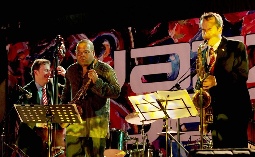 Ari Roland, Zaid Nasser and Chris Byars (from left) perform during a concert before several hundred people in Pakistan on Tueday. (Associated Press)
