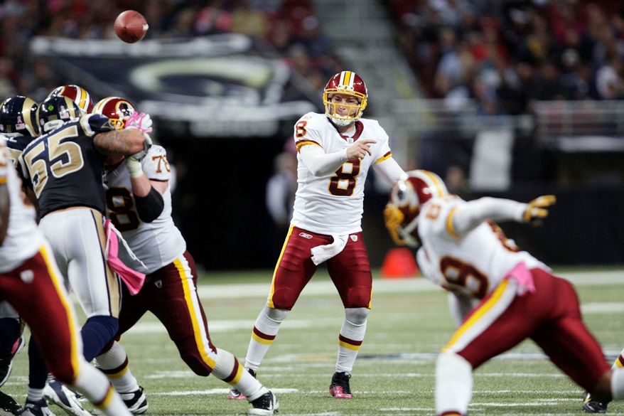 Redskins quarterback Rex Grossman was 15-of-29 for 143 yards with a touchdown two interceptions. His rating was 48.5. (Associated Press)