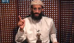 **FILE** In this image taken from video and released by SITE Intelligence Group on Nov. 8, 2010, Anwar al-Awlaki speaks in a video message posted on radical websites. (Associated Press)