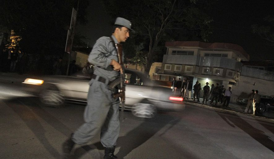 ** FILE ** An Afghan policeman and security forces stand guard in front of former Afghan president Burhanuddin Rabbani's house after he was killed in suicide attack in Kabul, Afghanistan, Tuesday, Sept. 20, 2011. (AP Photo/Kamran Jebreili)