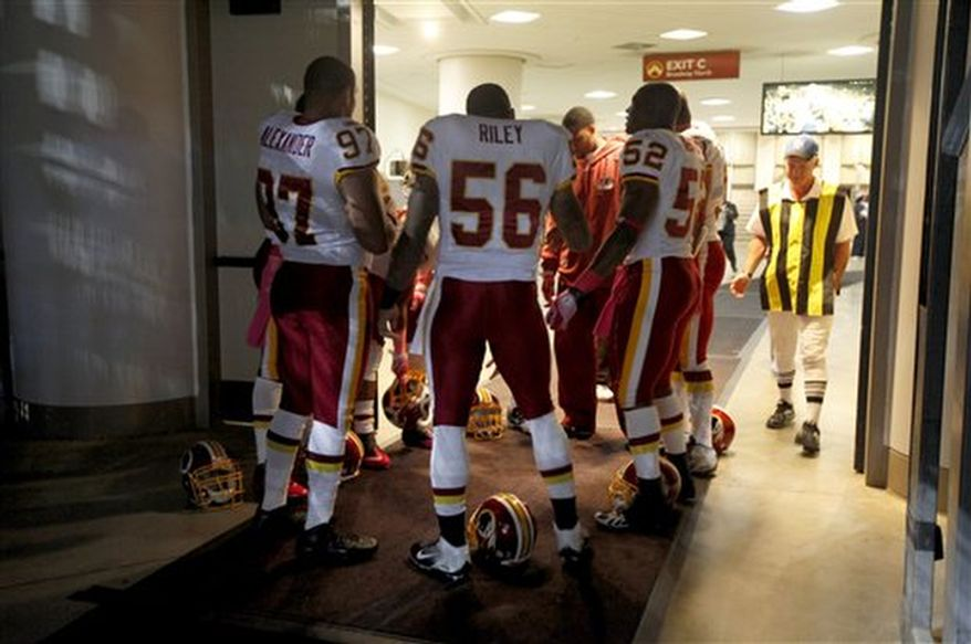 Members of the Washington Redskins are seen in the tunnel before the start of an NFL football game between the St. Louis Rams and the Washington Redskins Sunday, Oct. 2, 2011, in St. Louis. (AP Photo/Jeff Roberson)