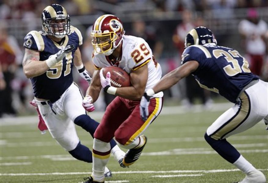 Washington Redskins running back Roy Helu runs between St. Louis Rams defenders Chris Long, left, and Bradley Fletcher during the first quarter of the NFL football game Sunday, Oct. 2, 2011, in St. Louis. (AP Photo/Tom Gannam)