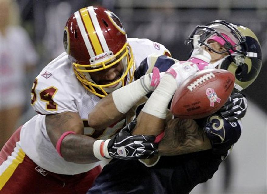 St. Louis Rams' Austin Pettis, right, loses the ball on a punt return as he is hit by Washington Redskins' Niles Paul during the second quarter of the NFL football game Sunday, Oct. 2, 2011, in St. Louis. The Rams recovered the ball and Paul was charged with an unnecessary roughness penalty on the play. (AP Photo/Seth Perlman)