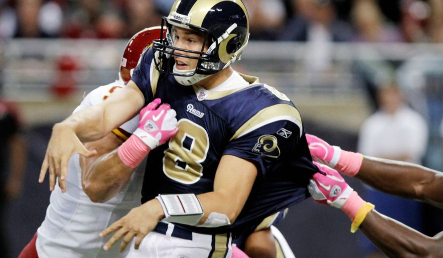 St. Louis Rams quarterback Sam Bradford was hounded by Washington Redskins defenders all afternoon. (AP Photo)