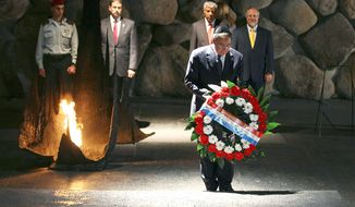 Defense Secretary Leon E. Panetta places a memorial wreath at Yad Vashem in Jerusalem on Monday, during his first trip to Israel as defense secretary. (Associated Press)