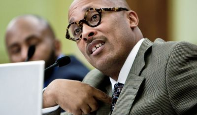Peaceoholics co-founder Ronald Moten testifies Monday before the D.C. Council about an audit of his anti-gang nonprofit, Peaceoholics. The D.C. auditor found grant-compliance mistakes. (T.J. Kirkpatrick/The Washington Times)