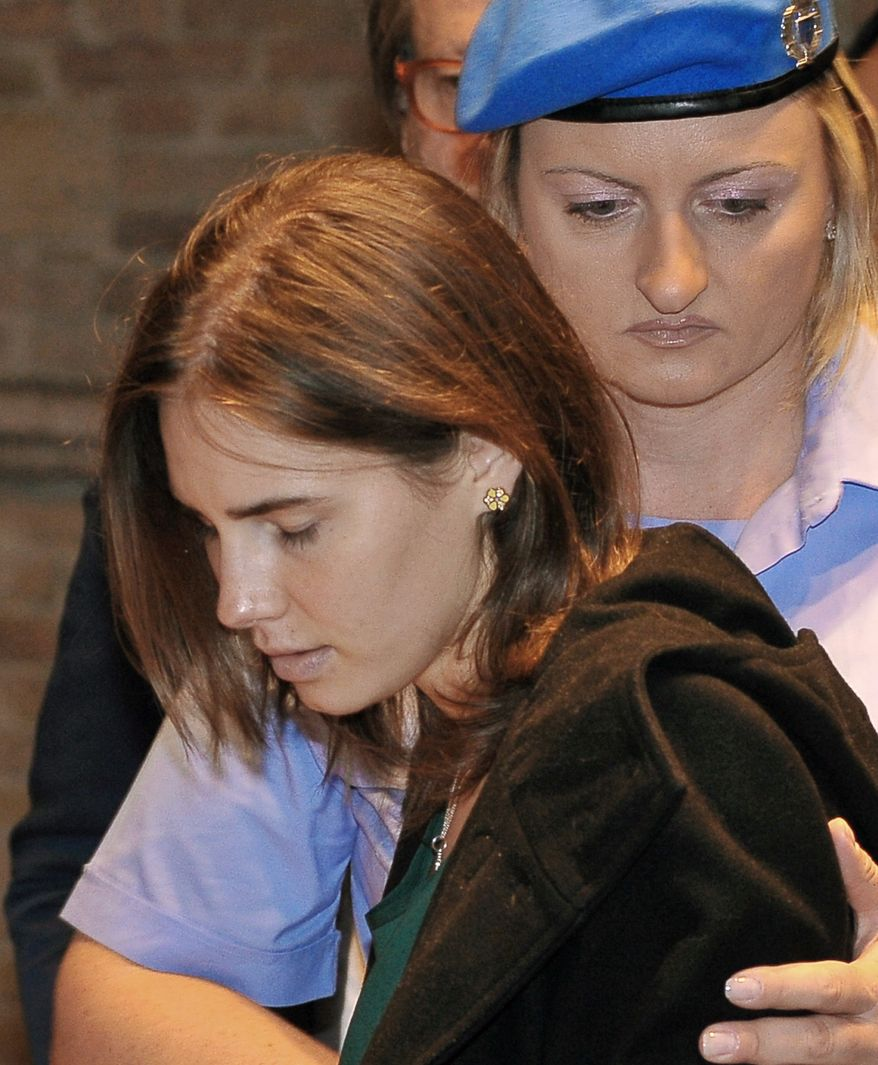 Amanda Knox, left arrives for an appeal hearing at the Perugia court, central Italy, Monday, Oct. 3, 2011. (AP Photo/Stefano Medici)