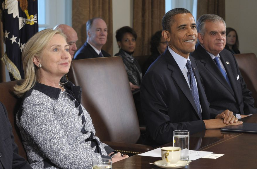 President Obama (center), flanked by Secretary of State Hillary Rodham Clinton (left) and Transportation Secretary Ray LaHood, makes a statement at the start of a Cabinet meeting at the White House on Oct. 3, 2011. (Associated Press)