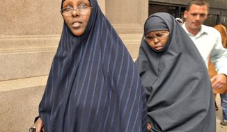 **FILE** In this photo from Aug. 5, 2010, Hawo Mohamed Hassan (left) and Amina Farah Ali, both of Rochester, Minn., leave U.S. District Court after appearing at a hearing in St. Paul, Minn. The two women are accused of funneling money to a terrorist group in Somalia, and are the first to go on trial in Minnesota's years-long federal investigation into the recruiting and financing of al-Shabab. (Associated Press)