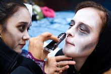 Rachel Schneider of Brooklyn, N.Y., has her face painted to resemble a zombie before a march Oct. 3, 2011, at the ongoing Occupy Wall Street demonstration in Zucotti Park, located in New York's financial district. (Associated Press)