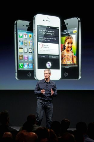 Apple CEO Tim Cook unveils the iPhone 4S at the company's headquarters in Cupertino, Calif. (Associated Press)