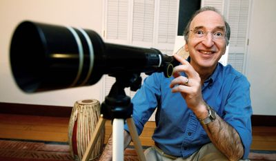 Saul Perlmutter, at his home in Berkeley, Calif., is all smiles Tuesday after learning he had won the Nobel Prize in physics. He shared the prize with Brian Schmidt and Adam Riess for their work mapping the universe's expansion by analyzing a particular type of supernova, or exploding star. (Associated Press)