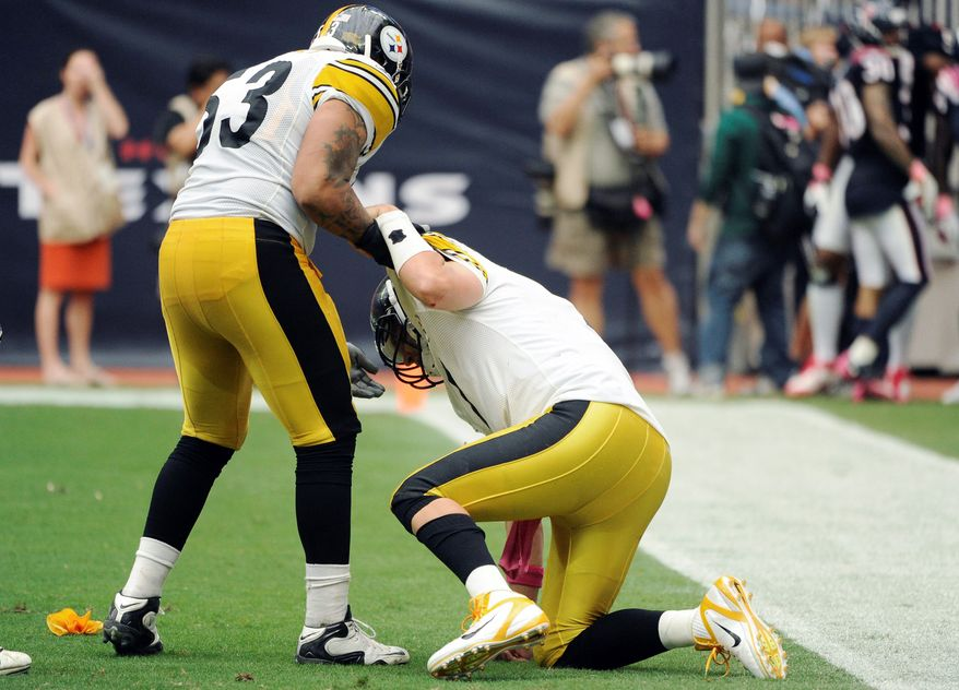 Pittsburgh quarterback Ben Roethlisberger (right) suffered a sprained foot in Sunday's loss at Houston. He's expected to play this week against Tennessee. (Associated Press)