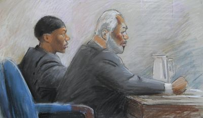 In this courtroom drawing, Umar Farouk Abdulmutallab (left) appears in federal court in Detroit on Oct. 4, 2011, with defense lawyer Anthony Chambers. Abdulmutallab is on trial for attempting to bring down a jetliner with a bomb in his underwear on Christmas 2009. (Associated Press)
