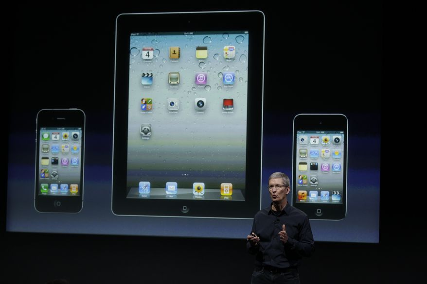 Apple CEO Tim Cook talk about iTouch, iPhone and iPad during an announcement at Apple headquarters in Cupertino, Calif., on Oct. 4, 2011. (Associated Press)