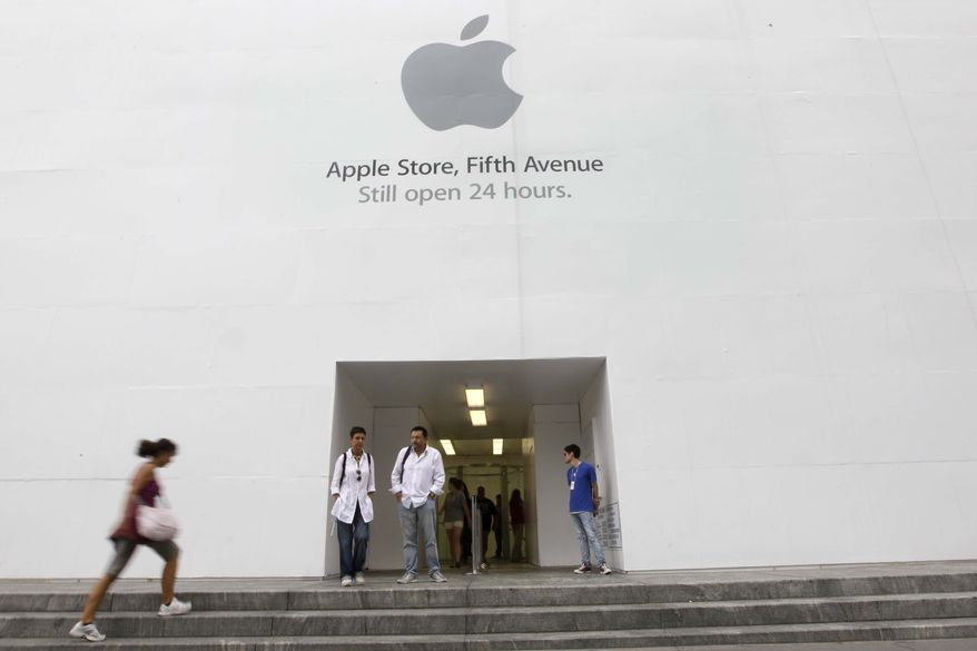 ** FILE ** In this Aug. 25, 2011, photo, customers stand outside the Apple flagship store on Fifth Ave., in New York. Apple fans are amped. The computer and gadget maker is expected to announce a new, more powerful version of its wildly popular smartphone this week, more than a year after it unveiled the iPhone 4. (AP Photo/Richard Drew)
