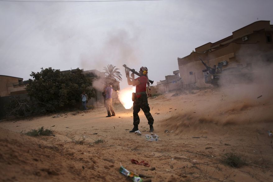 Libyan revolutionary fighters fire RPGs during an attack for the city of Sirte, Libya, on Oct. 3, 2011. Rebel forces are battling to make headway against loyalist fighters inside the home town of Libya's ousted leader Moammar Gadhafi. (Associated Press)
