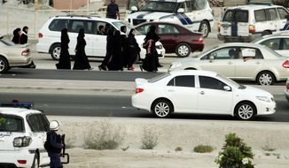 Bahraini riot police order a group of women to disperse when they tried to begin a planned human chain anti-government demonstration on Tuesday in Manama, Bahrain, near the offices of the main Shiite opposition society Al-Wefaq. Authorities banned the gathering, and a heavy police presence prevented it. Instead, those arriving switched to a traffic slowdown to show their displeasure, bringing vehicles to a crawl along a major highway. (Associated Press)
