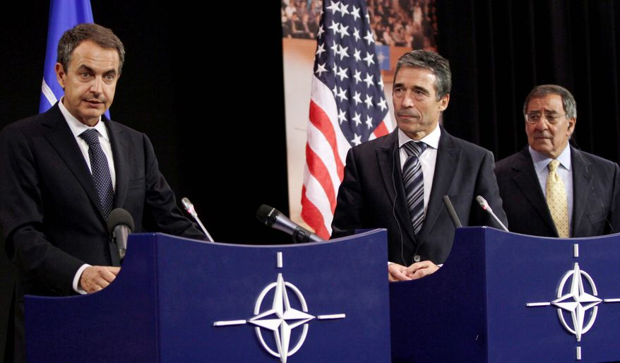 From left, Spanish Prime Minister Jose Luis Rodriquez Zapatero, NATO Secretary-General Anders Fogh Rasmussen and U.S. Defense Secretary Leon E. Panetta discuss defense after a meeting of NATO ministers in Brussels on Wednesday. (Associated Press)