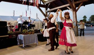 The annual Oktoberfest celebration in Cullman, Ala., added beer halls to the oompah bands and dancing for the first time Monday, thus ending the town's claim that it hosted the world's only dry Oktoberfest. (Associated Press)