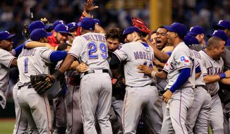Rangers players celebrated their 4-3 win over the Tampa Bay Rays on Tuesday that clinched a return trip to the ALCS. (Associated Press)