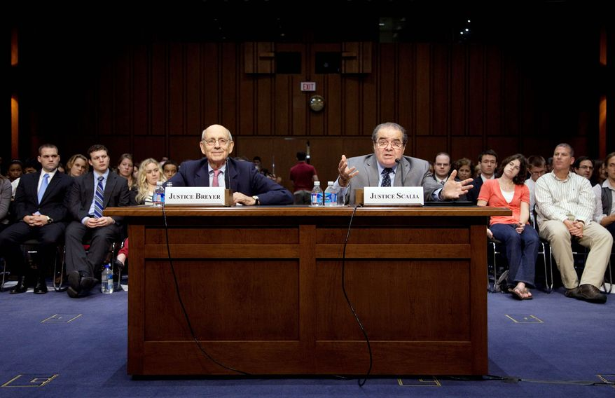 Supreme Court Justices Stephen G. Breyer and Antonin Scalia discuss their differing views of the Constitution before the Senate Judiciary Committee on Wednesday. (Associated Press)