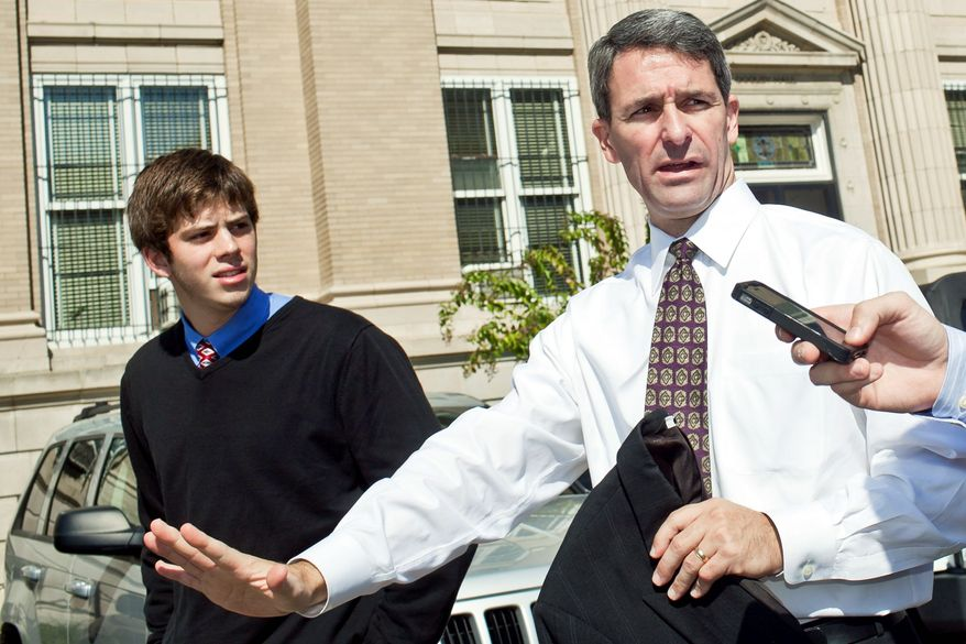 Virginia Attorney General Kenneth T. Cuccinelli II, Class of 1986, leaves Gonzaga College High School with Kevin Clark, a University of Virginia student and fellow Gonzaga graduate who helped bring the state's top prosecutor to the school. (T.J. Kirkpatrick/The Washington Times)