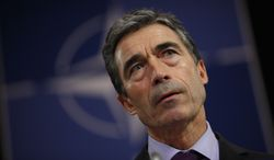 NATO Secretary-General Anders Fogh Rasmussen listens to questions during a media conference at NATO headquarters in Brussels on Monday, Oct. 3, 2011. (AP Photo/Virginia Mayo)