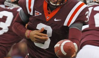 Virginia Tech quarterback Logan Thomas (3) hands off the ball during the first half against Clemson at Lane Stadium in Blacksburg, Va., Saturday, Oct. 1, 2011. (AP Photo/Steve Helber)