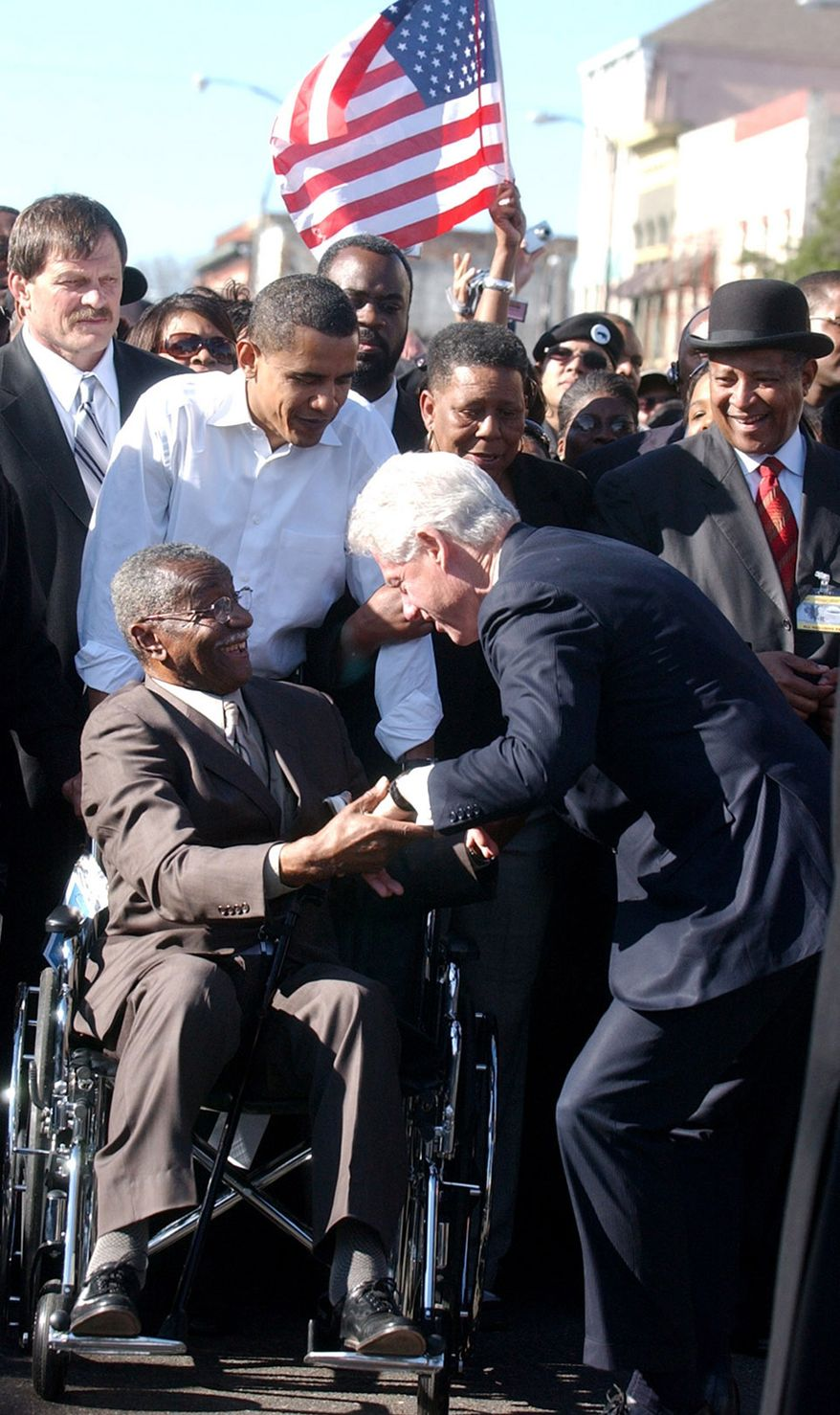 ** FILE ** Then-Sen. Barack Obama (second from left) looks on as the Rev. Fred L. Shuttlesworth (in wheelchair) greets former President Bill Clinton in Selma, Ala., in March 2007. (AP Photo/The Birmingham News, Linda Stelter)