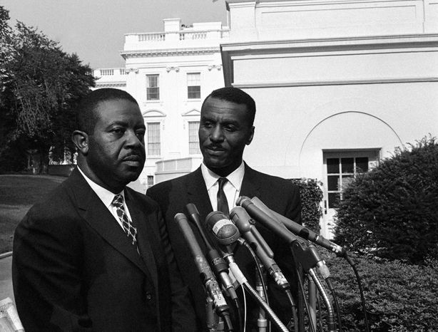 ** FILE ** The Rev. Ralph Abernathy (left) of the Southern Christian Leadership Conference in Atlanta and the Rev. Fred Shuttlesworth of the Revelation Baptist Church in Cincinnati talk to reporters at the White House in Washington after a conference with President Kennedy in 1963. (AP Photo/Bill Allen, File)