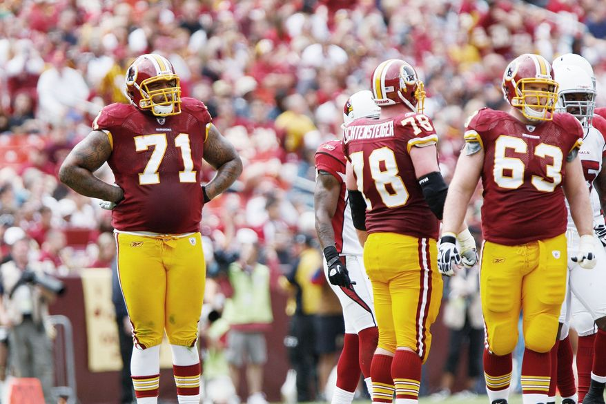 """T.J. KIRKPATRICK/THE WASHINGTON TIMES Left tackle Trent Williams (71) said there is less uncertainty when it comes to execution. """"There's not a lot of second-guessing as there was last year coming into a new system. I feel like we're all working together right now,"""""""