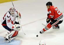 Capitals goalie Tomas Vokoun, shown blocking a shot by Chicago's Ben Smith on Sept. 23, supplanted Michal Neuvirth as the starter. Braden Holtby, also in the mix, likely will see more time at Hershey of the AHL.
