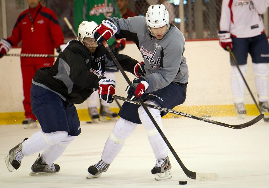 Center Mattias Sjogren (right) has benefited from playing in the Swedish Elite League. He won a silver medal with Sweden at the World Championship last season. (Rod Lamkey Jr./The Washington Times)