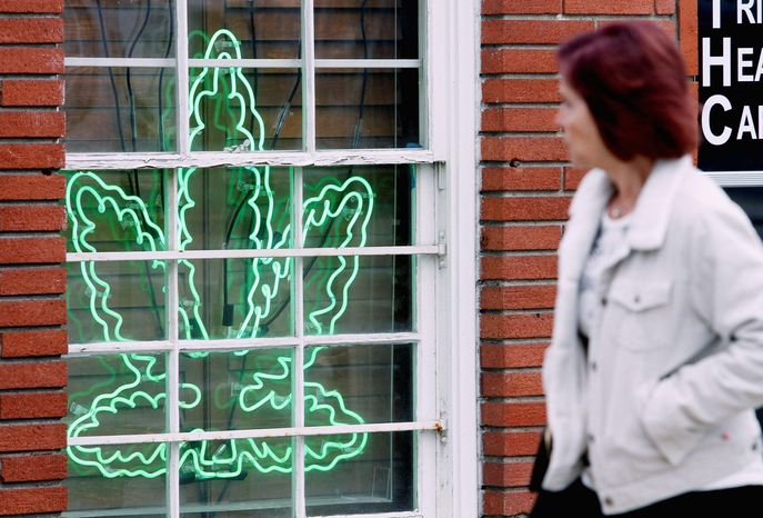 A marijuana leaf neon sign advertises a medical-pot provider in the Sherman Oaks section of Los Angeles. (Associated Press)