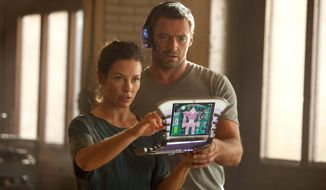 "Evangeline Lilly as Bailey, in a scene with Hugh Jackson, is the go-to person when robots need repairs after their bouts in ""Real Steel,"" rated PG-13 for mild profanity and robot mayhem. (Disney/Dreamworks II photograph via Associated Press)"