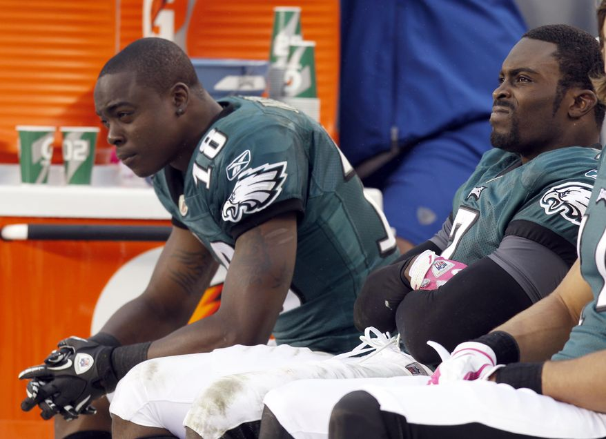 Philadelphia Eagles wide receiver Jeremy Maclin (18) and quarterback Michael Vick sit on the bench after Maclin's fumble in the second half of an NFL football game Sunday, Oct. 2, 2011 in Philadelphia. The 49ers won 24-23.(AP Photo/Alex Brandon)