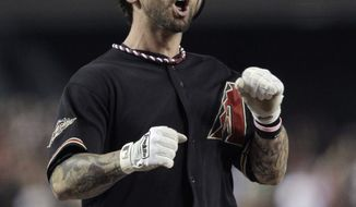 Arizona Diamondbacks' Ryan Roberts celebrates his first-inning grand slam against the Milwaukee Brewers in Game 4 of baseball's National League division series Wednesday, Oct. 5, 2011, in Phoenix. (AP Photo/Ross D. Franklin)