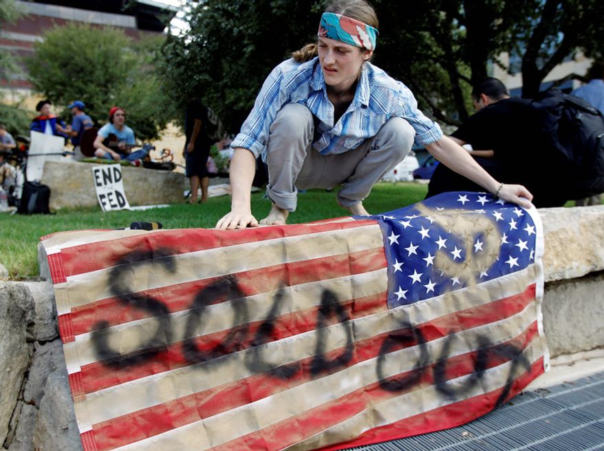 "Brighton Wallace takes part in an ""Occupy Austin"" protest at Austin City Hall, Thursday, Oct. 6, 2011, in Austin, Texas. (AP Photo/Eric Gay)"