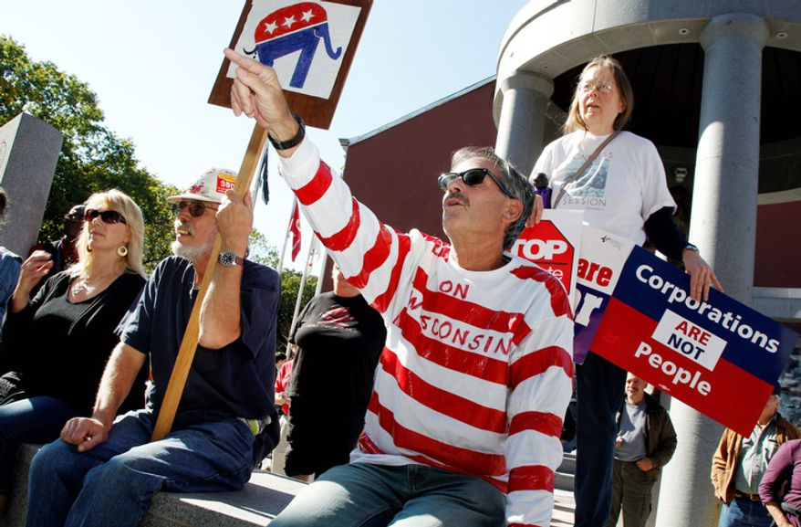 """Retired schoolteacher Larry Witlen wears """"On Wisconsin"""" on his shirt as he shouts out during a protest gathering across from the Statehouse in Trenton, N.J. (AP Photo/Mel Evans)"""