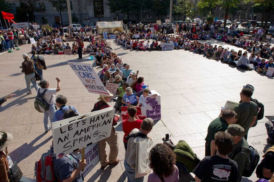 "Protesters form a huge human number ""99"" to symbolize the 99% of americans they are representing in a large protest against corporate greed at Freedom Plaza, Washington, DC, October 6,  2011. (Andrew Harnik / The Washington Times)"